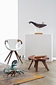 Designer armchair, walnut stool and stylised animal sculptures