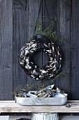 A wall wreath made of mussel shells and coral as maritime decoration