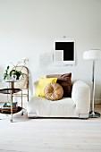 Corner armchair, retro hostess trolley and standard lamp