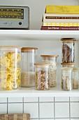 Storage jars and retro radio on kitchen shelves