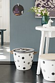 A white homemade stool decorated with grey spots