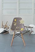 A modern grey chair decorated with fabric star stickers