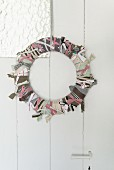 A homemade wreath made from strips of fabric