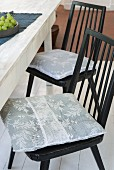 Homemade chair cushions made from white lace fabric