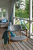 A homemade swing on a veranda
