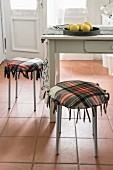 Stools with homemade cushions made from a checked woollen blanket