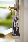 Vintage door hanger with picture of maid hung from antique door handle