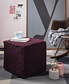 A knitted stool made from a mixed woollen yarn
