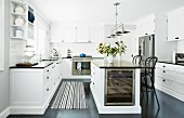 Kitchen island and Thonet bar stool in white, classic country house kitchen
