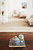 China sugar bowl and salt cellar on tile coaster