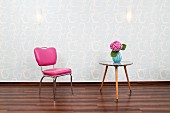 Hairdresser's waiting area with pink chair & triangular, 50s table