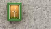 Miniature wind turbine in illuminated display case on grey concrete wall