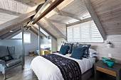 Modern attic conversion in wood with bedroom and ensuite bathroom
