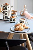 Retro crockery on round modern table