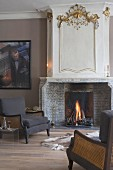 Dark brown armchairs next to fireplace in smoking room