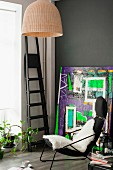 Vintage armchair, ladder and abstract painting in bold colours