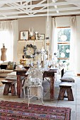 Festively set dining table in eclectic interior decorated for Christmas