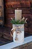 Pillar candle in stone-effect vase as Advent gift