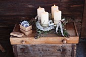 Star-shaped Advent wreath in rustic cabin