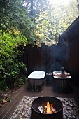 Outdoor fireplace and bathtubs, California