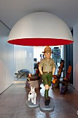 Tintin and Snowy statues under designer lamp