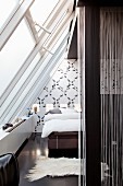 Monochrome bedroom under glass ceiling