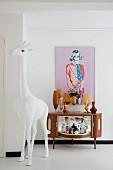White giraffe sculpture in front of home bar