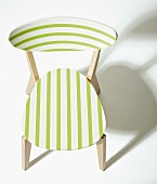 Wooden chair revamped with white and green stripes