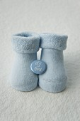 Blue baby socks with a badge