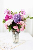 Bouquet of hydrangeas, wood anemones and mallows