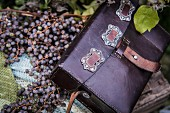Purple leather bag on berries