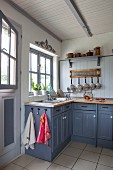 Country-style kitchen counter with blue-grey base units