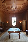 Games room with carved, wood-panelled ceiling