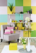House plants on white bracket shelves on wall decorated with pastel and yellow squares