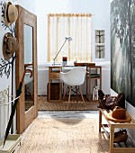 Cloakroom area with wall stickers and view of desk and shell chair