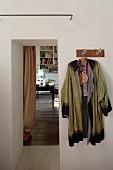 Kimono hung from coat rack next to open doorway