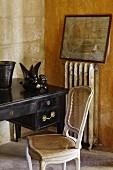 White vintage cane chair next to antique desk
