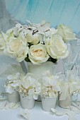 Bouquet of white hydrangeas and roses in white jug