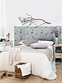 Fabric-covered bed headboard with folding sides in bedroom in natural style