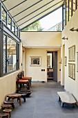 Glass gable window and ethnic stools in hallway
