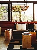 Solid wooden side tables and scatter cushions on sofa in lounge area