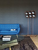 Designer furniture in modern living room in shades of blue
