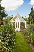 Victorian greenhouse in idyllic garden