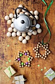 Star-shaped trivets made from wooden beads on rustic wooden surface