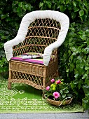 DIY - wicker armchair with seat cushion and white cushioned backrest edge