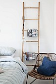 Bamboo ladder used as bedside table