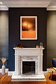 Open fireplace with marble surround on black chimney breast in elegant interior
