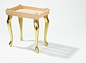 DIY tray table with golden legs made from wooden laths