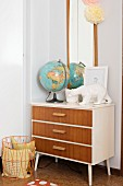 Globe and polar bear ornament on top of retro chest of drawers