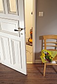 Old wooden door with fresh paintwork and polished handle